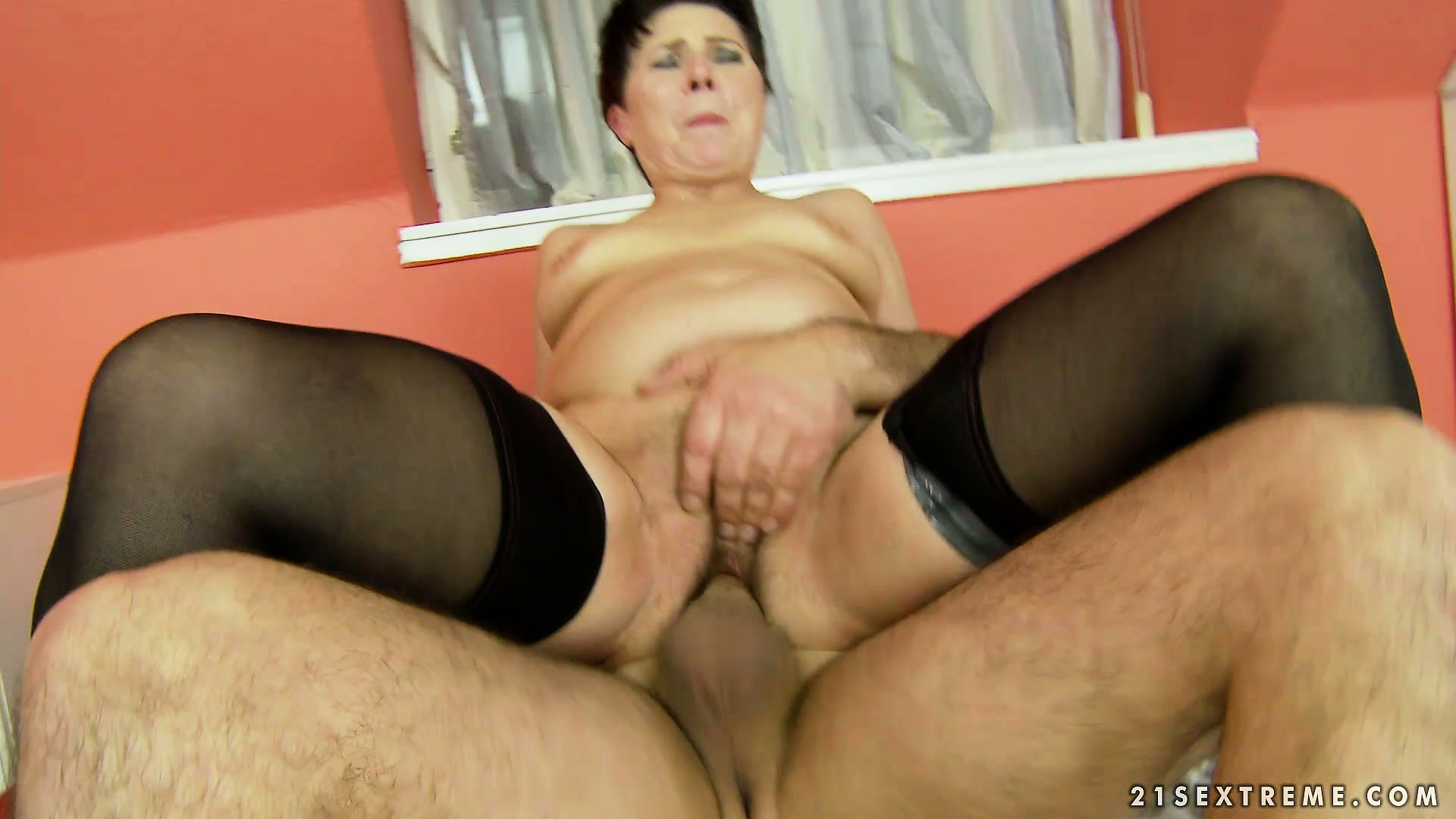 Porno Video of Sort-haired Hoochie In Stockings Rides On A Young Guy's Cock
