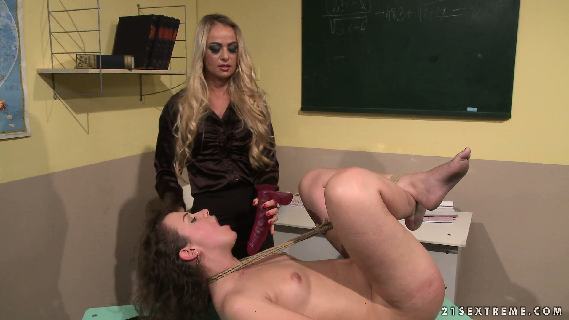 Porno Video of Evil School Teacher Devices Her Own Method For Punishing Her Students