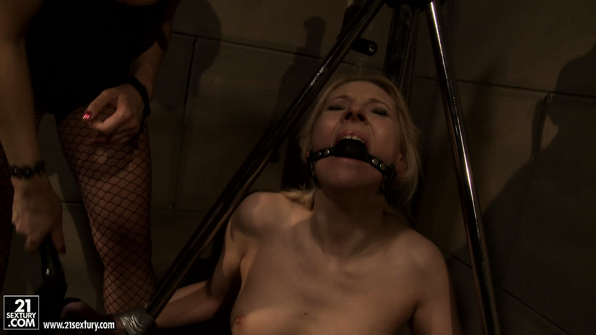 Porno Video of After A Good Whippin', The Mistress Gags This Naughty Blonde In Chains