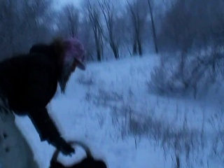 girlfriend is outside in the snow playing around getting ready to fuck