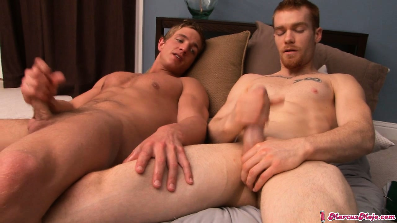 Porno Video of Two Handsome Fellows Sit On A Couch And Jerking Off Together