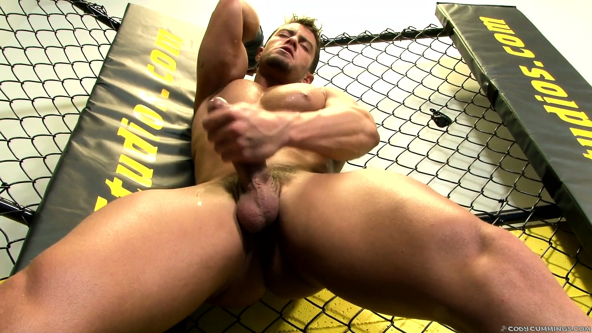 Porno Video of In The Fighting Cage, A Young Stud Displays His Awesome Body And His Big Shaft