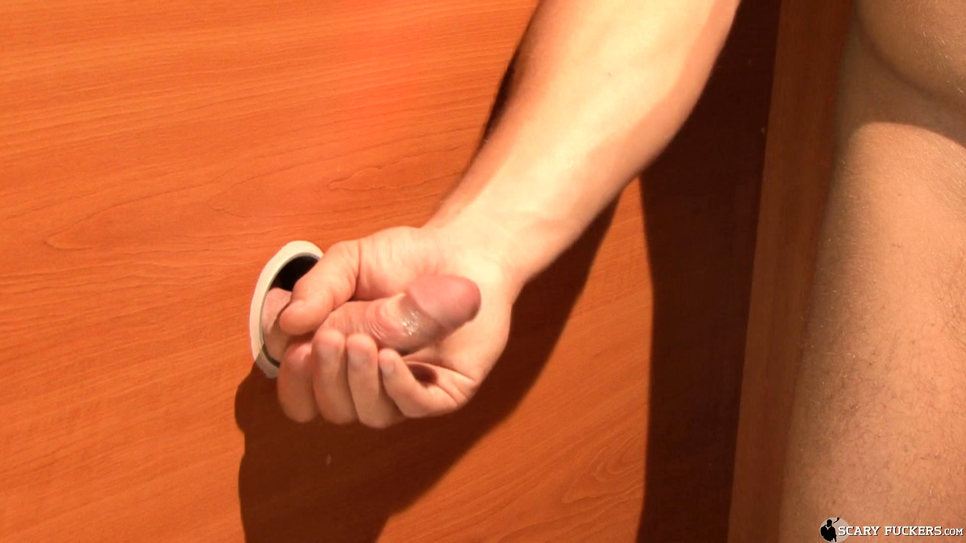 Porn Tube of Dude Finds Relief Thanks To The Cock Coming From The Glory Hole