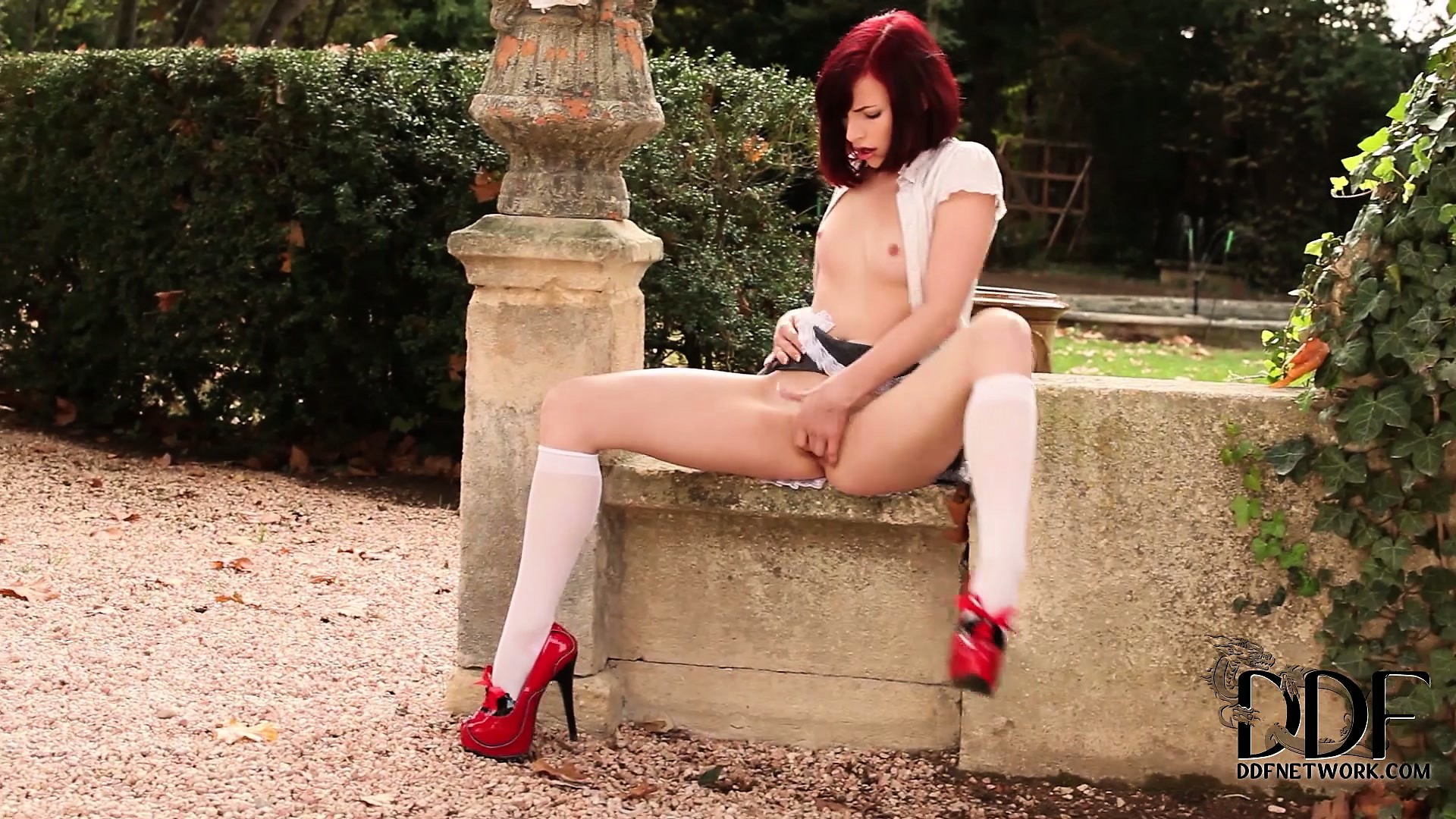 Porn Tube of Cute Little Redhead Out In The Yard Running Her Fingers Over And In Her Cunt