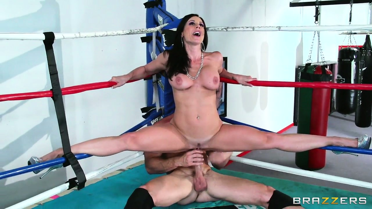 Porno Video of This Busty Brunette Milf Is Tied Up In The Ropes Getting Licked And Fucked In The Boxing Ring
