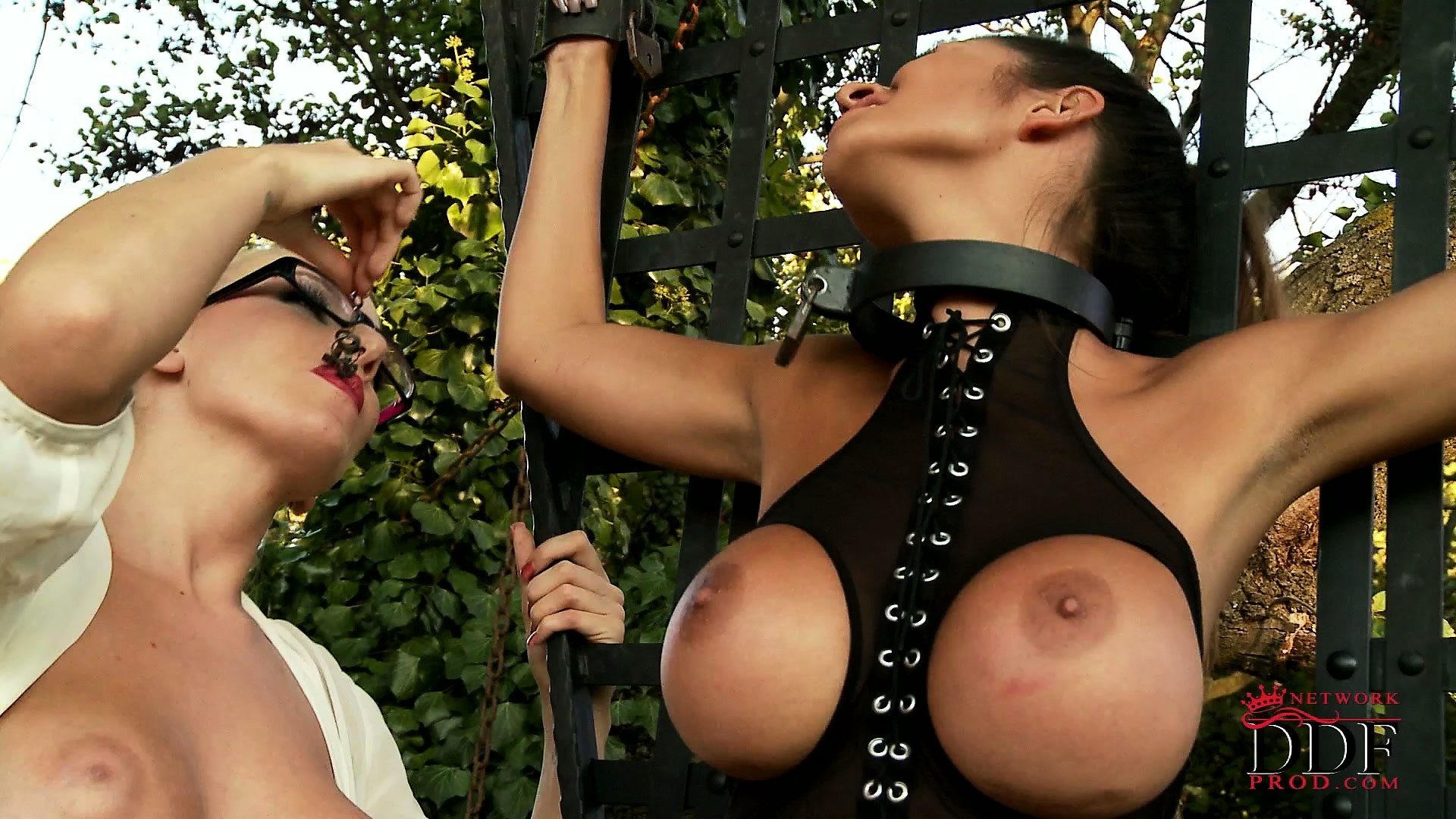 Porno Video of Busty Brunette Slave In Latex Is Strung Up And Tortured By Her Mistress