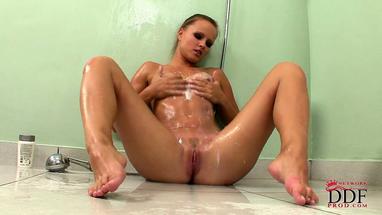 Porn Tube of Cute Little Innocent Brunette Gets Herself Off With The Shower Head