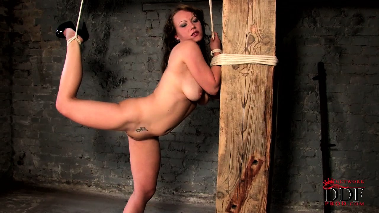 Porno Video of All Tied Up, A Curvy Babe With Big Tits Has A Black Vibrator Pleasing Her Pussy