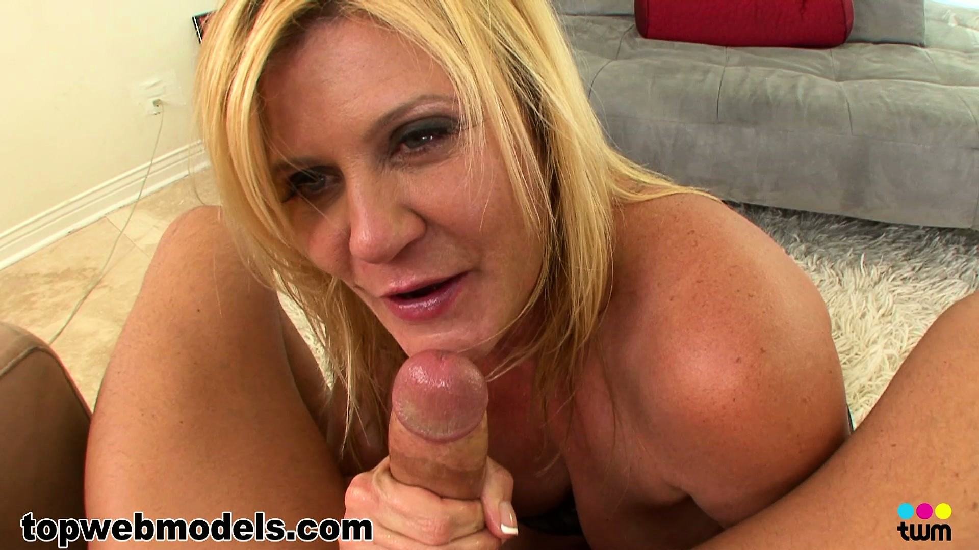 Porn Tube of Ginger Lynn Takes His Cock In Her Mouth While Fondling Her Tits