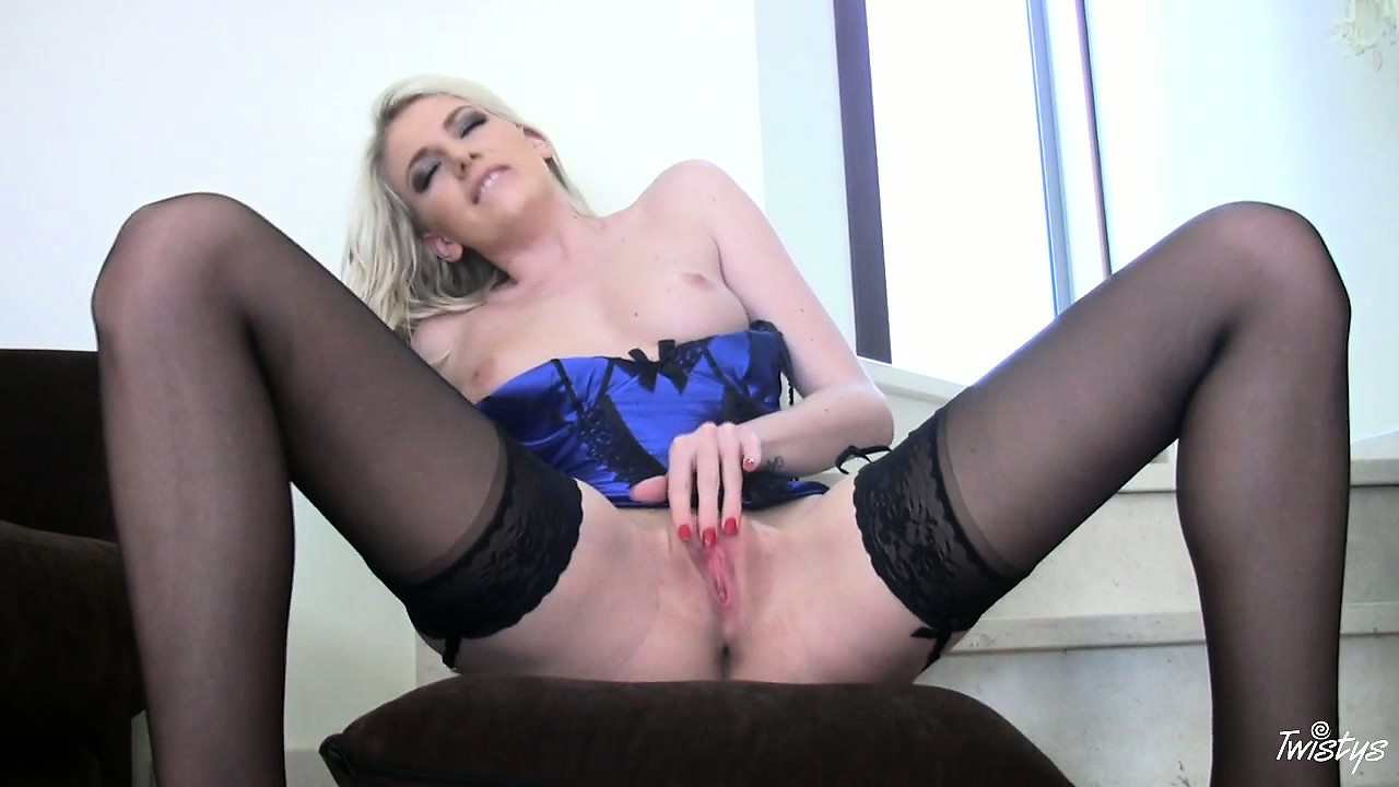 Porno Video of Blonde In A Tight Blue Corset And Stockings Gives Herself A Rub