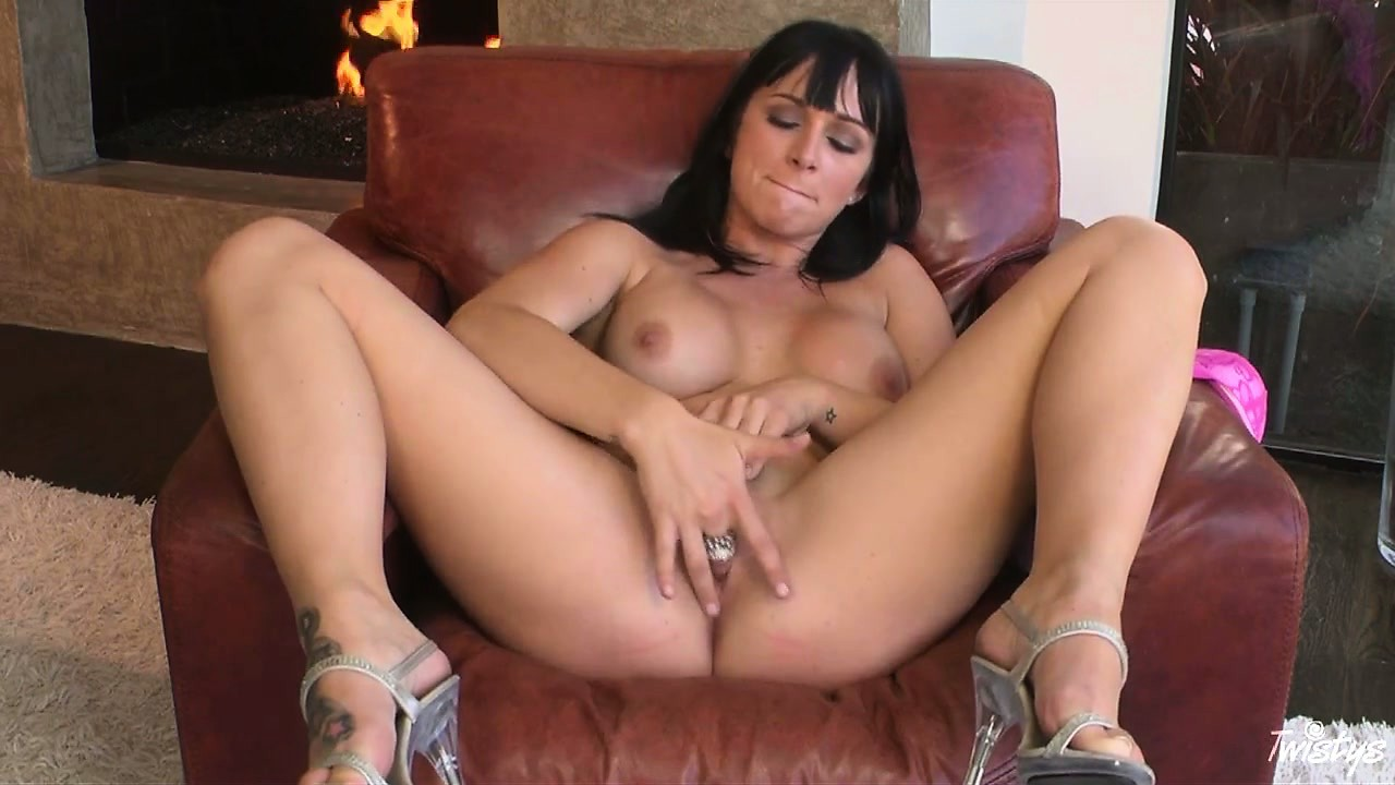 Porn Tube of Busty Babe Sits Naked On A Chair And Works On Rubbing Her Clit